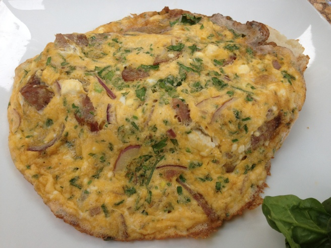 Spanish omelette with sausage, Spanish onions, tomato, goats cheese and fresh herbs - Si Drivani, South Yarra