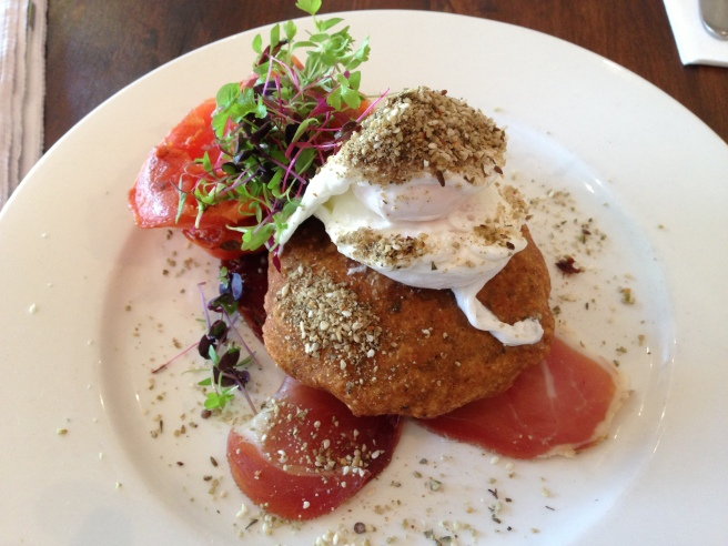Dukkah Eggs - chickpea pattie, prosciutto, poached eggs, house-dried tomatoes, labna and pepita seed dukkah - Red Robyn, Camberwell