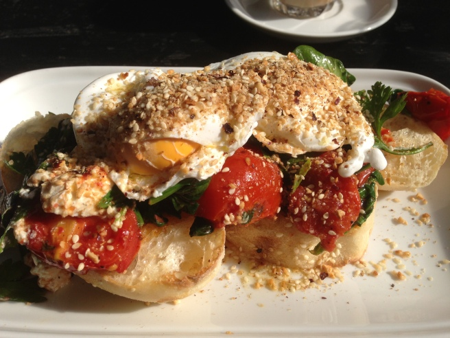 Middle Eastern eggs - poached eggs sprinkled with dukkah on toasted Turkish bread with roast tomato, spinach and labna - Bella Sistas, Camberwell South