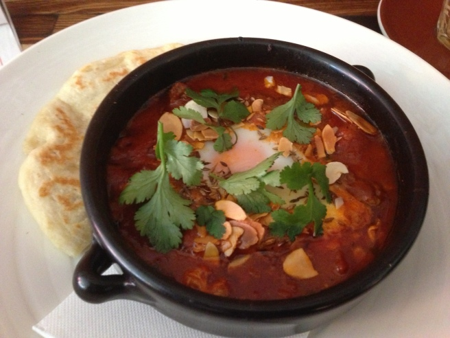 Baked egg in a tagine of duck kofta with tomato, ras el hanout, toasted almonds and coriander served with Batbout (small Moroccan bread) - Crabapple Kitchen, Hawthorn