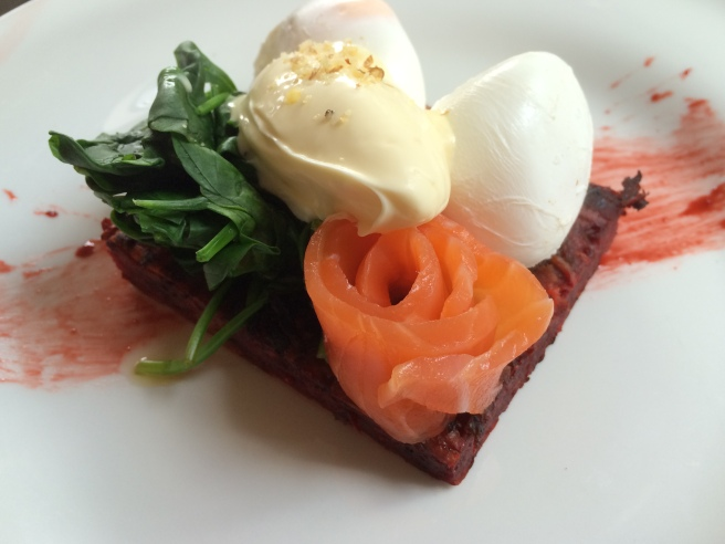 Sweet Potato & Beetroot Fritters with house-cured salmon carpaccio, spinach, horseradish & walnut cream served with two poached eggs - Two Lost Boys, Windsor