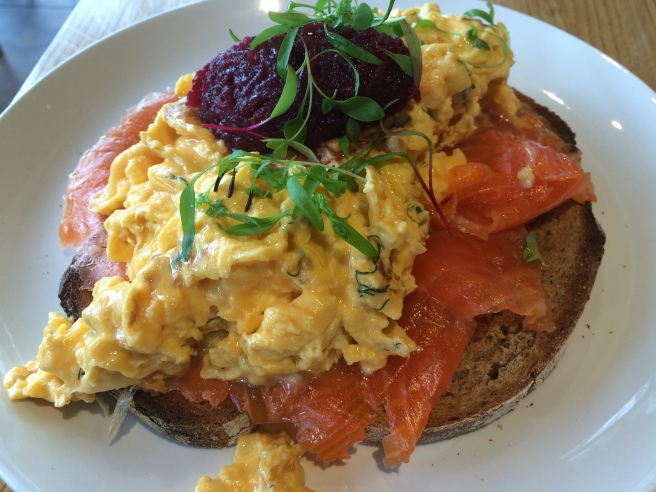 Gin and dill cured ocean trout with creamy goats cheese and dill scrambled eggs, beetroot relish on toasted rye - Urban Provedore, South Yarra