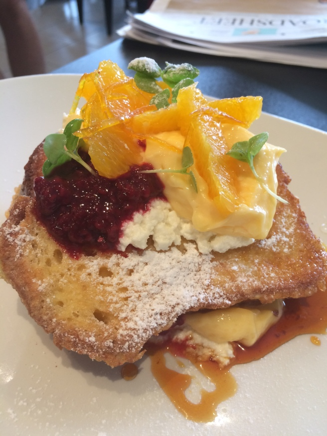 "Brioche French Toast ""St Clements"" with lemon curd, fresh orange, ricotta, candied zest, raspberry compote, baby basil and burnt orange syrup - Lolo and Wren, Brunswick West"