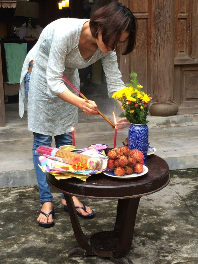 Young tailor preparing for full moon,  Hoi An - Vietnam Culinary Discovery