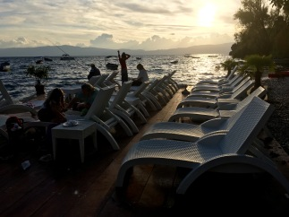 Watching the sun go down at a bar by Lake Ohrid - Real Food Adventure Macedonia and Montenegro