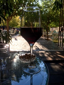 Enjoying a glass of Greek red wine at a cafe in Metaxourgio, Athens