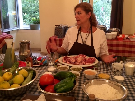 Fofi explaining the cooking process - Athens Cooking Lessons