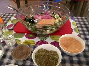 Preparing the spinach and cheese pie filling - Athens Cooking Lessons