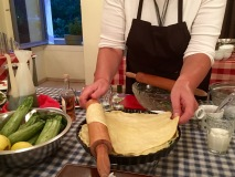 Adding the top layer of pastry - Athens Cooking Lessons