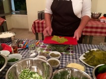 Fofi demonstrating how to roll domades - Athens Cooking Lessons