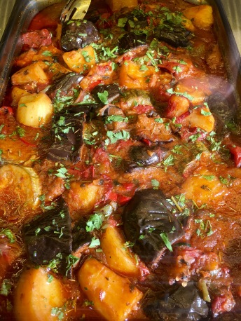 Baked eggplant, tomatoes and potatoes